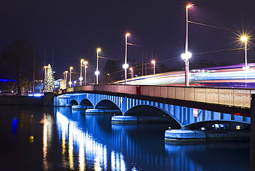 Lights illuminate a bridge over lake zurich at night, Zurich switzerland