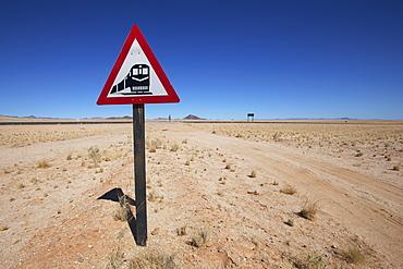 Railway traffic sign beside a desert road, Garub namibia