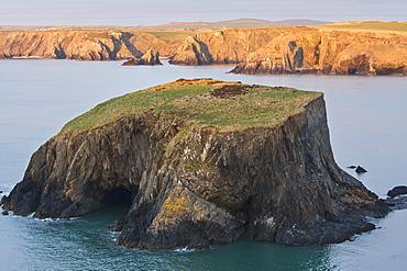 Small Island And Cliffs At Sundown Near Trefin Village On The Pembrokeshire Coast Path, Wales
