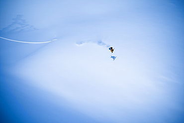Extreme Snowboarding On A Snow Covered Slope, Haines, Alaska, United States Of America