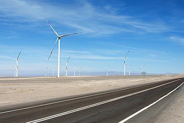 A Road Running Beside A Field Full Of Wind Turbines, Calama, Antofagasta Region, Chile
