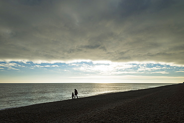 Mother And Daughter Walking Along Beach, Aldeburgh, Suffolk, England
