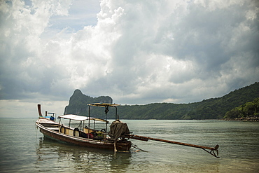 A Fishing Boat Sits In The Main Bay Of Koh Phi Phi Island In The Andaman Sea, Thailand