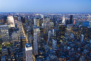 Panoramic View Of The Skyscrapers And The East River At Dusk, As Seen From The Empire State Building, New York City, New York, United States
