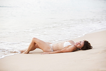 A Young Woman Laying On The Beach In The Caribbean, Caribbean