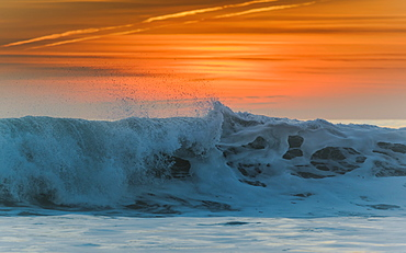 Waves Breaking At The Shore With A Glowing Orange Sky At Sunset, Tarifa, Cadiz, Andalusia, Spain