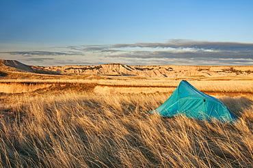 Tent At Camp Site In Sage Creek Wilderness Area, Badlands National Park, South Dakota, United States Of America