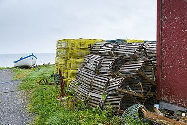Lobster Traps Piled By A Harbour, Sally's Cove, Newfoundland, Canada