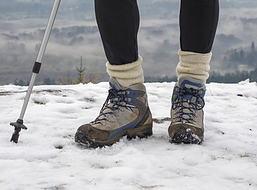 A Woman Hikes In The Snow On The Hills Of Vancouver Island, Duncan, British Columbia, Canada
