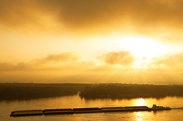 Agriculture - Grain Barge Navigating The Mississippi River In Early Morning Light / Near Hannibal, Missouri, Usa.