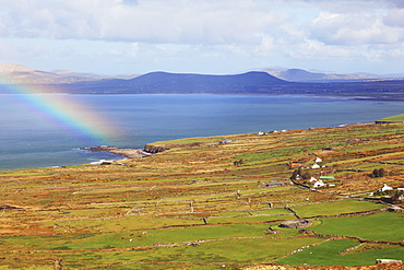 A Rainbow Off The Shoreline Over The Water, Near Waterville With Ballinskelligs Bay, County Kerry, Ireland