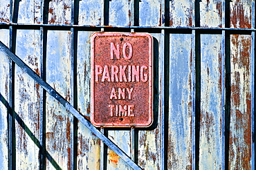 Louisiana, New Orleans, No Parking Sign On Gated Fence.