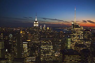 New York City Buildings Illuminated At Nighttime, New York City, New York, United States Of America
