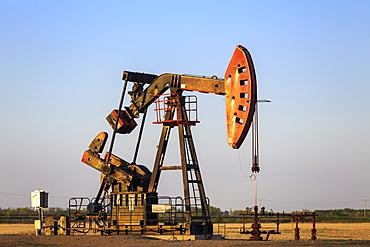 Oil Well Pump Jack In The Bakken Oil Field, Near Estevan, Saskatchewan, Canada