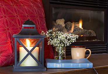 A Bible, Candle And Mug Sit On The Fireplace Hearth, Yarrow, British Columbia, Canada