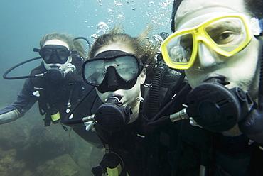 Scuba Divers Posing Underwater, Ixtapa-Zihuatanejo, Guerrero, Mexico