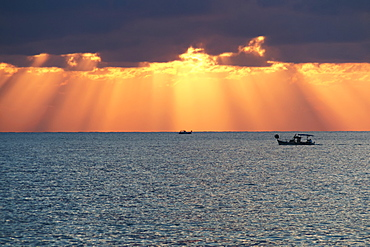 Dramatic Sky With Sun Rays Filtering Down Out Of The Storm Clouds Over The Horizon, Paphos, Cyprus