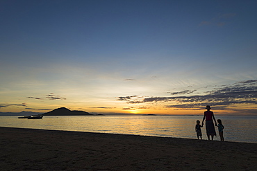 Silhouette Of Mother With Boy And Girl On Beach At Cape Maclear At Sunset, Lake Malawi, Malawi