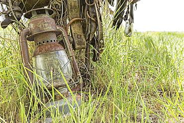 An Old Lantern Lay Against A Post In Rural Saskatchewan, Val Marie, Saskatchewan, Canada