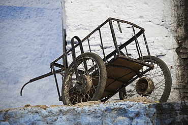 Old Cart Resting Amongst Faded Blue And White Painted Buildings, Chefchaouen, Morocco