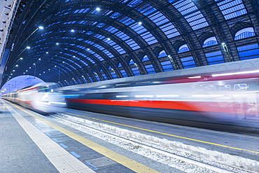 Motion Blur Of Speeding Train In Train Station, Milan, Lombardy, Italy