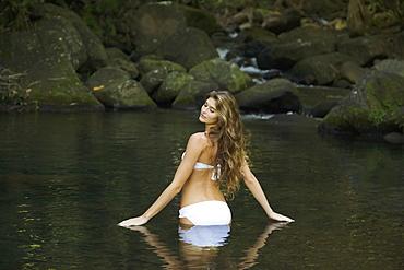 Woman In A White Bikini Standing In The Water, Kauai, Hawaii, United States Of America