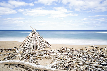 Driftwood Structures Along A Beach, Wailua, Kauai, Hawaii, United States Of America