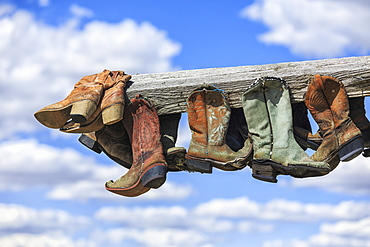 Old Cowboy Boots Hanging In Memory Of John Booth, Great Sandhills, Near Sceptre, Saskatchewan, Canada