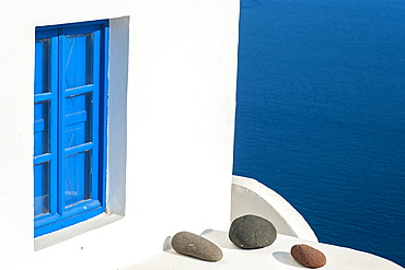 Whitewash Building With Blue Trimmed Window Along The Aegean Sea, Oia, Santorini, Greece