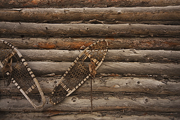 Snowshoes On Old Log House, Yellowknife, Northwest Territories, Canada