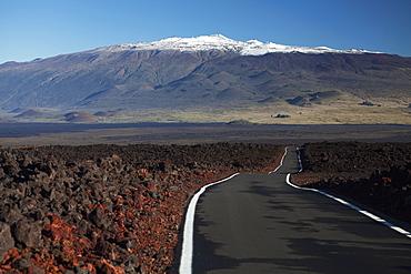 Lava Fields Of Mauna Loa, Mauna Loa Strip Road (Stainback Road), Snowcapped Mauna Kea, Island Of Hawaii, Hawaii, United States Of America
