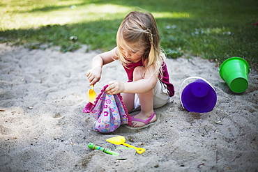 A Young Girl Plays In The Sand, Surrey, British Columbia, Canada