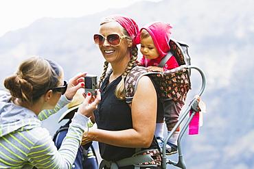 A Family Overlooks The Breathtaking Views Over Waimea Canyon, Kauai, Hawaii, United States Of America
