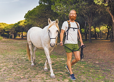 A Man Walking With A White Horse, Cadiz, Andalusia, Spain