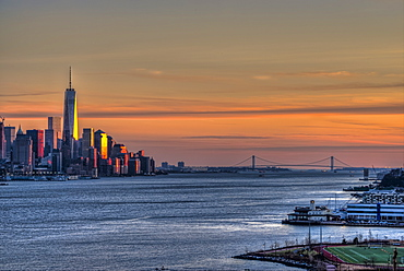 Sunset Over Lower Manhattan And The Verrazano-Narrows Bridge, Weehawken, New Jersey, United States Of America