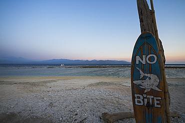 No Bite Sign On The Beach At Dusk, Gili Trawangan, West Nusa Tenggara, Indonesia