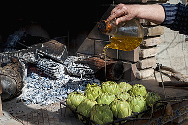 Artichokes With Olive Oil Soon To Be Cooked, Tarragona, Benissanet, Spain