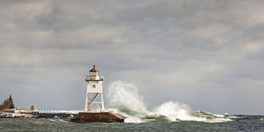 Large Waves Splashing Up To A Lighthouse, Grand Marais, Minnesota, United States Of America