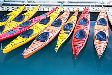 View Of Colorful Kayaks Tied To The Harbor Dock In Valdez, Southcentral Alaska, Summer