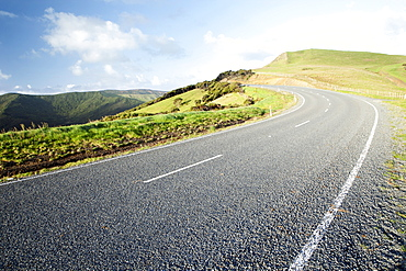Perspective Of A Curving Road On The Top Of A Mountain, North Island, New Zealand