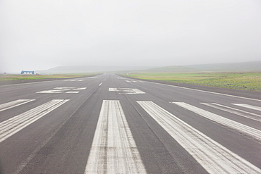 View Down The Runway Of The St. Paul Airport On A Misty Afternoon, St. Paul Island, Southwestern Alaska, USA, Summer