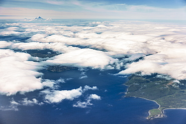 Aerial View Of Popof Island, Low Altitude Clouds Obscuring The Island, Sand Point, Southwestern Alaska, USA, Summer