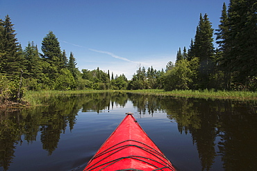 Red Bow Of A Boat On A Tranquil Lake, Ontario, Canada
