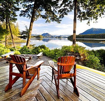 Wooden Adirondack Chairs On A Deck Overlooking The Water, Tofino Chalet On Jensen's Bay, Tofino, British Columbia, Canada