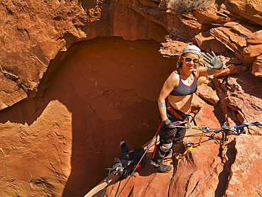 Female Adventurer Exploring A Desert Slot Canyon, San Rafael Swell, Utah, United States Of America