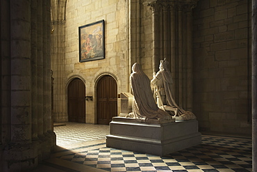 The Statue Of A Royal Couple Caught In Beautiful Light In The Grandiose Basilica Of Saint Denis, Paris, France