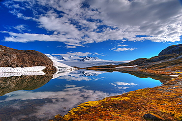 A Crystal Clear Lake Near The Harding Icefield Trail With The Harding Ice Field In The Background, Kenai Fjords National Park, Alaska, United States Of America