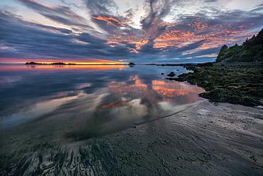 Sunrise And Reflections At Low Tide In Chiniak Bay, Kodiak, Alaska, United States Of America
