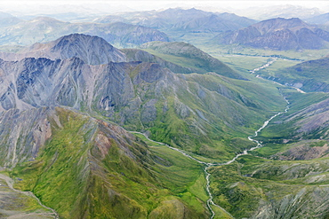 Aerial View Of A River Cutting Through A Valley In The Brooks Range, Alaska, United States Of America