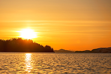 The Setting Sun Silhouettes The Forest Ridges And Peninsulas In Prince William Sound, Whittier, Alaska, United States Of America